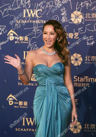 Coco Lee Taiwanese-American singer Coco Lee waves to photographers as she attends the closing ceremony of the 5th Beijing International Film Festival in the Huairou district of Beijing