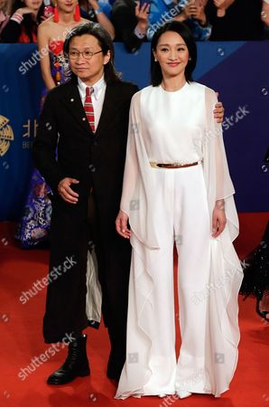 Zhou Xun, Peter Chan Chinese actress Zhou Xun, right, and Hong Kong director Peter Chan pose on the red carpet as they attend the closing ceremony of the 5th Beijing International Film Festival, in Beijing