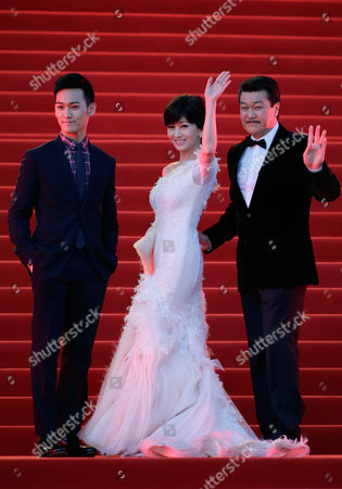 Angie Chiu, Melvin Wong, Wesley Wong Hong Kong actress Angie Chiu, center, and her husband Melvin Wong, right, wave next to their son Wesley Wong as they attends the closing ceremony of the 5th Beijing International Film Festival in the Huairou district of Beijing