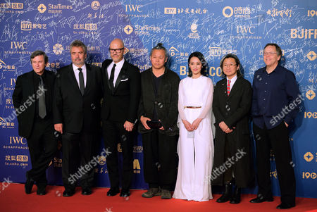 Robert Kamen, Luc Besson, Fyodor Bondarchuk, Kim Ki-duk, Zhou Xun, Peter Chan, Fernando Meirelles The Jury of the Tiantan awards from left, U.S. writer Robert Kamen, French director Luc Besson, Russian director Fyodor Bondarchuk, South Korea's director Kim Ki-duk, Chinese actress Zhou Xun, Hong Kong director Peter Chan and Brazilian director Fernando Meirelles pose for photographers on the red carpet as they attend the closing ceremony of the 5th Beijing International Film Festival in the Huairou district of Beijing