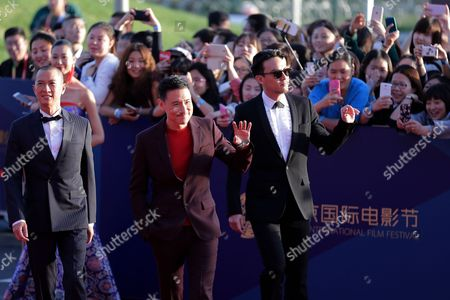 Jacky Cheung, Nick Cheung, Zhang Zhen Hong Kong actors Jacky Cheung, center, Nick Cheung, left, and Taiwanese actor Zhang Zhen, right, wave to spectators as they attend the closing ceremony of the 5th Beijing International Film Festival in the Huairou district of Beijing