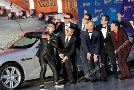 """Jacky Cheung, Nick Cheung, Zhang Zhen, Longmond Leung, Sunny Luk Chinese host Cao Yang, left, takes a selfie with members of the movie """"Helios"""", Hong Kong actors Jacky Cheung, right, Nick Cheung, third from right, Taiwanese actor Zhang Zhen, third from left, movie directors Longmond Leung, second from left, and Sunny Luk, fourth from right, on the red carpet as they attend the closing ceremony of the 5th Beijing International Film Festival in the Huairou district of Beijing"""