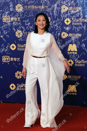 Zhou Xun Chinese actress Zhou Xun poses for photographers as she attends the closing ceremony of the 5th Beijing International Film Festival, in Beijing