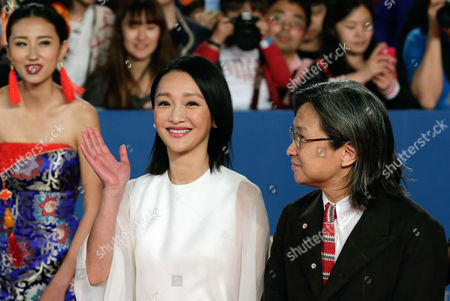 Zhou Xun, Peter Chan Chinese actress Zhou Xun, left, waves next to Hong Kong director Peter Chan as they attend the closing ceremony of the 5th Beijing International Film Festival, in Beijing