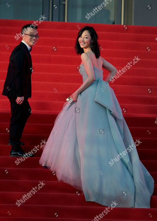 """Xu Chengyi, Bai Baihe Director of the movie """"Monster Hunt"""" Xu Chengyi, left, and Chinese actress Bai Baihe look back as they attend the closing ceremony of the 5th Beijing International Film Festival in the Huairou district of Beijing"""