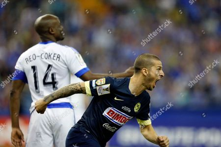 Dario Benedetto, Nigel Reo-Coker Club America forward Dario Benedetto, right, celebrates after scoring a goal as Montreal Impact midfielder Nigel Reo-Coker looks on during the second half of the CONCACAF Champions League final game, in Montreal. Club America won 4-2