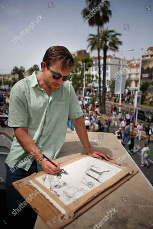 British artist Dan Llywelyn Hall sketches a scene from the Palais des Festivals at the 68th international film festival, Cannes, southern France. For the first time, the Cannes Film Festival has appointed an official artist, British painter Dan Llywelyn Hall