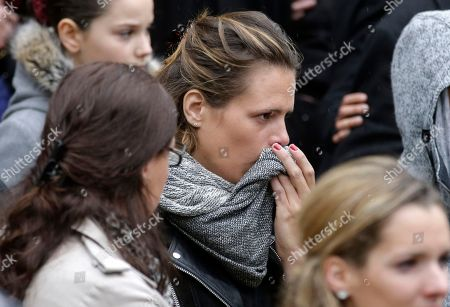 """French swimmer Laure Manaudou, leaves after attending the French Olympic champion swimmer Camille Muffat's funeral in Nice, southeastern France, . Muffat, a cast member of the European TV reality show """"Dropped,"""" was killed on March 9, 2015 when two helicopters carrying cast members collided in midair, also killing seven other French nationals including sailor Florence Arthaud and Olympic bronze-medalist boxer Alexis Vastine, and two Argentine pilots, in Villa Castelli, Argentina"""