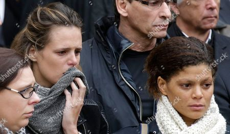 """French swimmers Coralie Balmy, right, and Laure Manaudou, leave after attending the French Olympic champion swimmer Camille Muffat's funeral in Nice, southeastern France, . Muffat, a cast member of the European TV reality show """"Dropped,"""" was killed on March 9, 2015 when two helicopters carrying cast members collided in midair, also killing seven other French nationals including sailor Florence Arthaud and Olympic bronze-medalist boxer Alexis Vastine, and two Argentine pilots, in Villa Castelli, Argentina"""