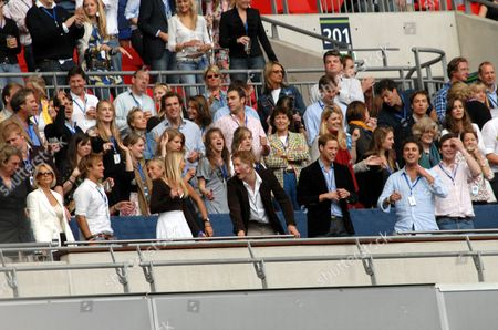 Chelsy Davy  (centre left, front row), Prince Harry, Prince William, Lady Jane Fellowes and Kate Middleton (2 levels above, far right)