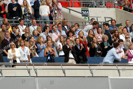 Chelsy Davy (centre left, front row), Prince Harry, Prince William, Lady Jane Fellowes, Kate Middleton (2 levels above, far right) and Zara Phillips