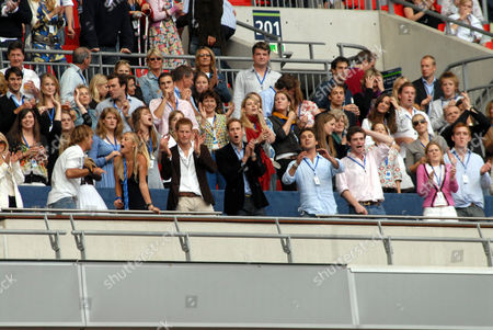 Chelsy Davy, Prince Harry, Prince William, Lady Jane Fellowes, Kate Middleton ( 2 levels above, far right), Zara Phillips and Mike Tindall