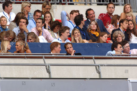 Chelsy Davy (front row 2nd from left), Prince Harry, Prince William, Lady Jane Fellowes and Kate Middleton (level above, far right)