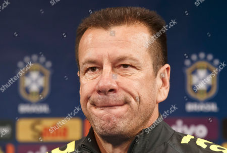 Brazil's soccer team coach Carlos Dunga, pauses as he speaks to the media during a press conference prior to a training session of the Brazil national soccer team at Stade de France stadium in Saint Denis, outside Paris, . Brazil will play against France in an International friendly soccer match at Stade de France on Thursday