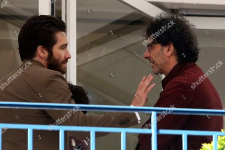 Jury president Joel Coen, right, and jury member Jake Gyllenhall speak on a terrace at a hotel ahead of the 68th international film festival, Cannes, southern France, . The festival opens on Wednesday, May 13 and runs until Sunday, May 24