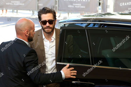 Jury member Jake Gyllenhall, right, arrives ahead of the 68th international film festival, Cannes, southern France, . The festival opens on Wednesday, May 13 and runs until Sunday, May 24