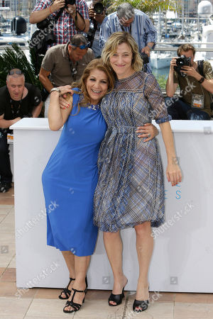 Actors Tassadit Mandi, left, and Valeria Bruni-Tedeschi pose for photographers during a photo call for the film Asphalte (Macadam Stories), at the 68th international film festival, Cannes, southern France