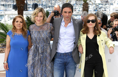 Stock Image of Tassadit Mandi, Valeria Bruni-Tedeschi, director Samuel Benchetrit, and Isabelle Huppert from left to right pose for photographers during a photo call for the film Asphalte (Macadam Stories), at the 68th international film festival, Cannes, southern France