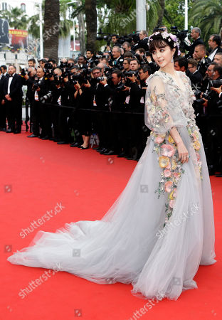 Actress Fan Bing Bing poses for photographers as she arrives for the screening of the film Mad Max: Fury Road at the 68th international film festival, Cannes, southern France