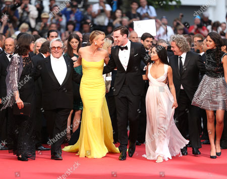 Director George Miller, Charlize Theron, Nicholas Hoult, Zoe Kravitz and producer Doug Mitchell pose for photographers on the red carpet for the screening of the film Mad Max: Fury Road at the 68th international film festival, Cannes, southern France