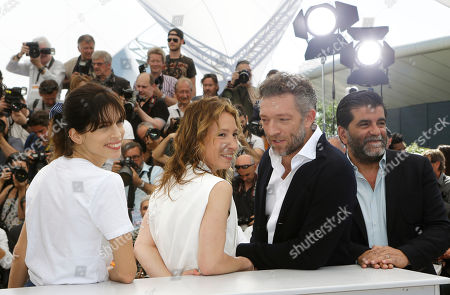 From left, director Maiwenn, actors Emmanuelle Bercot, Vincent Cassel, and producer Alain Attal pose for photographers during a photo call for the film Mon Roi (My King), at the 68th international film festival, Cannes, southern France