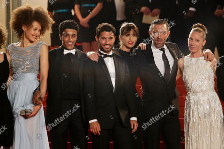 From left, actors Chrystele Saint Louis Augustin, Nabil Kechouhen, Abdel Addala, director Maiwenn, actors Vincent Cassel, and Emmanuelle Bercot arrive for the screening of the film Mon Roi (My King) at the 68th international film festival, Cannes, southern France