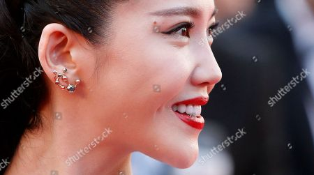 Actress Yang Zishan poses for photographers as she arrives for the screening of the film Mia Madre (My Mother) at the 68th international film festival, Cannes, southern France