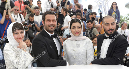 Director Ida Panahandeh, actors Navid Mohammadzadeh, Sareh Bayat, and Pejman Bazeghi, from left to right pose for photographers during a photo call for the film Nahid, at the 68th international film festival, Cannes, southern France
