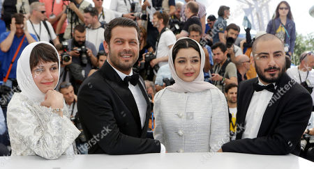 From left, director Ida Panahandeh, actors Navid Mohammadzadeh, Sareh Bayat, and Pejman Bazeghi pose for photographers during a photo call for the film Nahid, at the 68th international film festival, Cannes, southern France