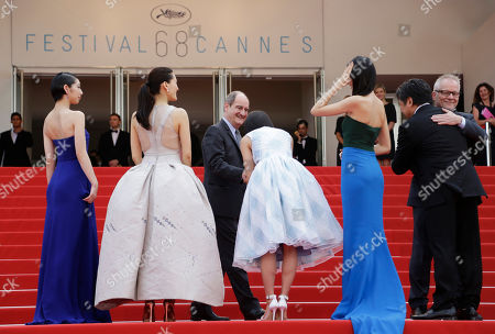 From front left, actors Khao, Haruka Ayase, Suzu Hirose, Masami Nagasawa and director Hirokazu Kore-Eda are welcomed by festival president Pierre Lescure, center back, and festival director Thierry Fremaux, back right, as they arrive for the screening of the film Our Little Sister at the 68th international film festival, Cannes, southern France