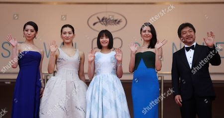 From left, actors Khao, Haruka Ayase, Suzu Hirose, Masami Nagasawa and director Hirokazu Kore-Eda pose for photographers as they arrive for the screening of the film Our Little Sister at the 68th international film festival, Cannes, southern France