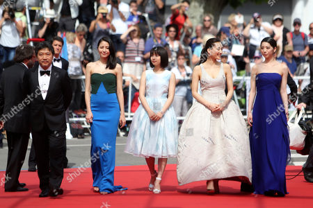 From right, actors Khao, Haruka Ayase, Suzu Hirose, Masami Nagasawa and director Hirokazu Kore-Eda pose for photographers as they arrive for the screening of the film Our Little Sister at the 68th international film festival, Cannes, southern France