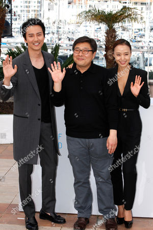 Kim Nam-gil, director Oh Seung-uk and Jeon Do-yeon pose for photographers during a photo call for the film Mu-roe-han (The Shameless), at the 68th international film festival, Cannes, southern France