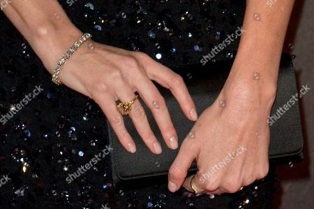"""Charlize Theron's rings are seen as she poses during a photocall for the French premiere of """"Dark Places"""" by French director Gilles Paquet-Brenner, in Paris, France"""