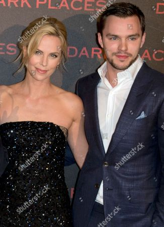 """Actors Charlize Theron, left, and Nicholas Hoult pose during a photocall for the french premiere of """"Dark Places"""" by French director Gilles Paquet-Brenner, in Paris, France"""