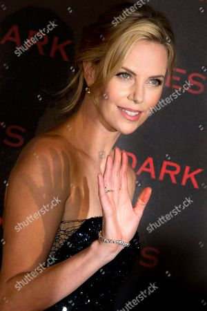 """Charlize Theron waves to photographers as she poses during a photocall for the French premiere of """"Dark Places"""" by French director Gilles Paquet-Brenner, in Paris, France"""
