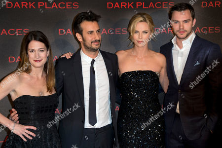 """From left, writer Gillian Flynn, director Gilles Paquet-Brenner, and actors Charlize Theron, and Nicholas Hoult pose during a photocall for the French premiere of """"Dark Places"""" by French director Gilles Paquet-Brenner, in Paris, France"""