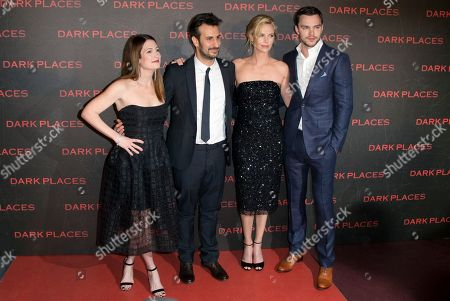"""From left, writer Gillian Flynn, director Gilles Paquet-Brenner and actors Charlize Theron, and Nicholas Hoult pose during a photocall for the French premiere of """"Dark Places"""" by French director Gilles Paquet-Brenner, in Paris, France"""