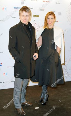 """French actress Clotilde Courau, right, and French actor Stanislas Merhar attend the photocall an exhibition """"Des Lumieres! Le Cinema Invente"""" (some lights ! invented movies) in Paris, France"""