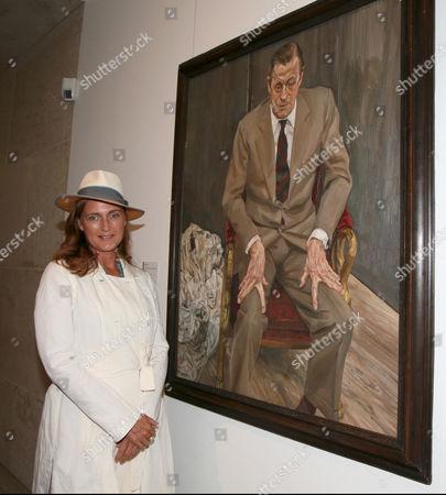 Baroness Francesca von Thyssen with a portrait of Baron H.H. Thyssen-Bornemisza by Lucian Freud