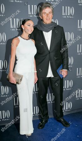 CEO of the Lucien Barriere Group Dominique Desseigne, right, and Alexandra Cardinale attend the 'Paris Merveilles' Lido New Revue Opening Gala at Le Lido, Paris