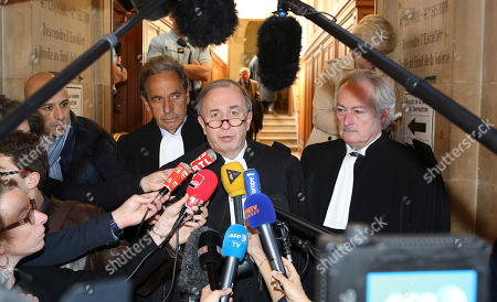 Nicolas Sarkozy' lawyer Pierre Haik, center, with at his side Thierry Herzog's lawyers Philippe-Dehapiot, right, and Paul Albert Iweins, left, addresses reporters at Paris court house ; after the Paris appeals court has ruled that investigating judges didn't break any laws when they tapped conversations between former President Nicolas Sarkozy and his lawyer Thierry Herzog, in connection with a probe into past campaign financing