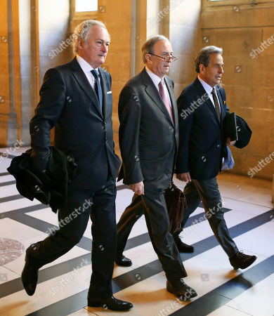 Thierry Herzog's lawyers Philippe-Dehapiot, left, and Paul Albert Iweins, right, arrive with Nicolas Sarkozy' lawyer Pierre Haik, center, at Paris court house for the ruling on the facts that judges didn't break any laws when they wiretapped Nicolas Sarkozy in 2013-2014 . The Paris appeals court has ruled that investigating judges didn't break any laws when they tapped conversations between former President Nicolas Sarkozy and his lawyer Thierry Herzog, in connection with a probe into past campaign financing