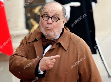 French TV director Serge Moati arrives for a dinner in honor of Tunisian President Beji Caid Essebsi, at the Elysee Palace in Paris, France, . Tunisian President Behi Caid Essebsi is on a two-day state visit in France