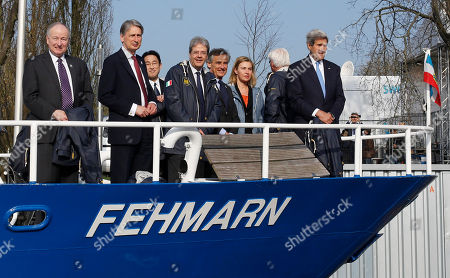 From left, Canadian Foreign Minister Rob Nicholson, British Foreign Secretary Philip Hammond, Japanese Foreign Minister Fumio Kishida, Italian Foreign Minister Paolo Gentiloni, the mayor of Luebeck Bernd Saxe, European Union High Representative for Foreign Affairs and Security Policy Federica Mogherini, German Foreign Minister Frank-Walter Steinmeier and United States Secretary of State John Kerry talk use a boat on their way to a working session during a meeting of the G7 Foreign ministers in Luebeck, northern Germany, . The meeting is being held ahead of the G7 leaders summit in Germany from June 7 to 8, 2015