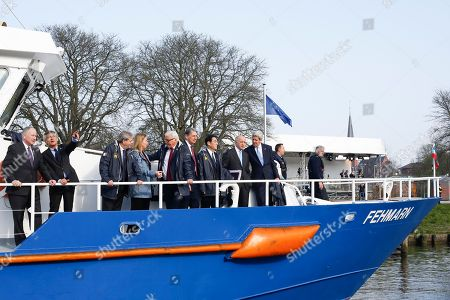 From left, Canadian Foreign Minister Rob Nicholson, the mayor of Luebeck Bernd Saxe, Italian Foreign Minister Paolo Gentiloni, European Union High Representative for Foreign Affairs and Security Policy Federica Mogherini, German Foreign Minister Frank-Walter Steinmeier, British Foreign Secretary Philip Hammond, Japanese Foreign Minister Fumio Kishida, French Foreign Minister Laurent Fabius and United States Secretary of State John Kerry stand on a boat for transport to a working session during a meeting of the G7 Foreign ministers in Luebeck, northern Germany, . The meeting is being held ahead of the G7 leaders summit in Germany from June 7 to 8, 2015