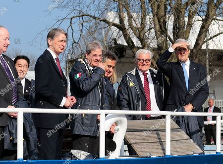 From left, Canadian Foreign Minister Rob Nicholson, Japanese Foreign Minister Fumio Kishida, British Foreign Secretary Philip Hammond, Italian Foreign Minister Paolo Gentiloni, the Mayor of Luebeck Bernd Saxe, German Foreign Minister Frank-Walter Steinmeier and United States Secretary of State John Kerry use a boat for transport to a working session during a meeting of the G7 Foreign Ministers in Luebeck, northern Germany, . The meeting is being held ahead of the G7 leaders summit in Germany from June 7 to 8, 2015
