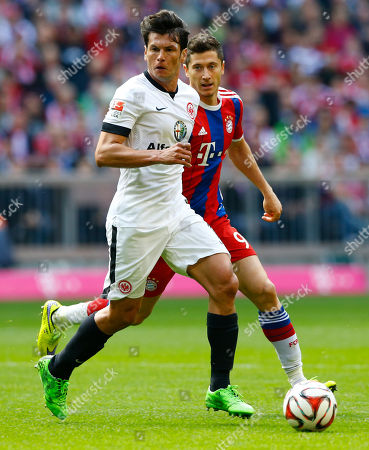 Frankfurt's Nelson Valdez from Paraguay, forgeround, and Bayern's Robert Lewandowski from Poland challenge for the ball during the German first division Bundesliga soccer match between FC Bayern Munich and Eintracht Frankfurt in the Allianz Arena in Munich, Germany, on