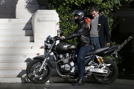 Yanis Varoufakis, Euclid Tsakalotos Greek Finance Minister, Yanis Varoufakis, left, and Deputy Foreign Minister For International Economic Relations, Euclid Tsakalotos, prepare to leave on a motorcycle from the Prime Minister's office in Athens . The two ministers had a meeting with Prime Minister Alexis Tsipras and Deputy Prime Minister Giannis Dragasakis, as the country faces a mounting challenge to meet its debt obligations as talks with rescue creditors have so far failed to break an impasse over future cost-cutting reforms