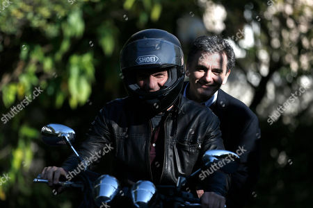Yanis Varoufakis, Euclid Tsakalotos Greek Finance Minister, Yanis Varoufakis, drives his motorcycle with Deputy Foreign Minister For International Economic Relations, Euclid Tsakalotos riding pillion as they leave the Prime Minister's office in Athens . The two ministers had a meeting with Prime Minister Alexis Tsipras and Deputy Prime Minister Giannis Dragasakis, as the country faces a mounting challenge to meet its debt obligations as talks with rescue creditors have so far failed to break an impasse over future cost-cutting reforms